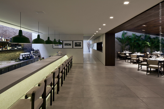 Counter space in the foreground and entrance corridor in the bac